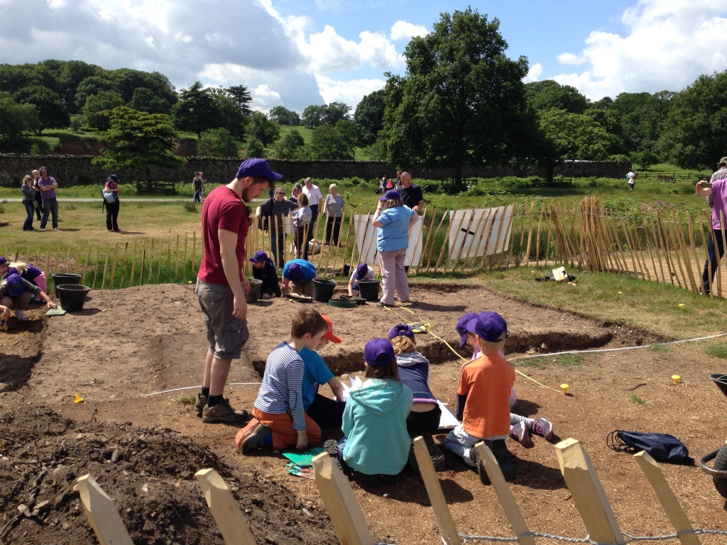 Children learning how to draw archaeological plans during an excavation of a medieval hunting lodge at Bradgate Park.