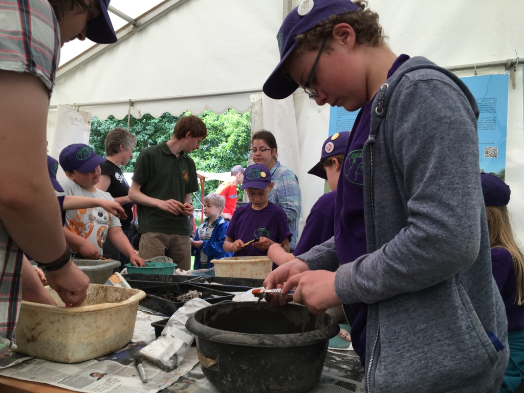 Children washing archaeological finds during an excavation at Bradgate Park.