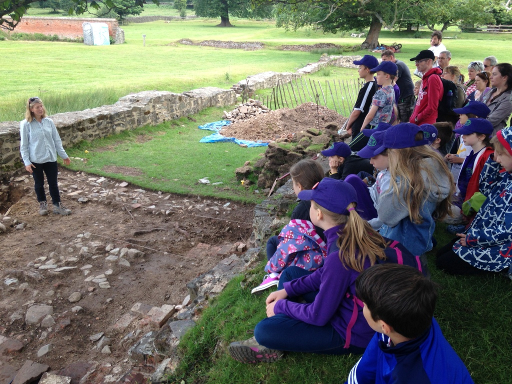 Children getting a site tour of the University of Leicester's excavations at Bradgate Park.