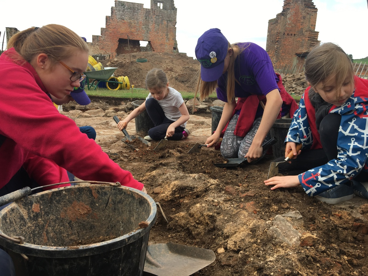Children excavating soil from a demolished wall in the ruins of Bradgate House, the birthplace of Lady Jane Grey.