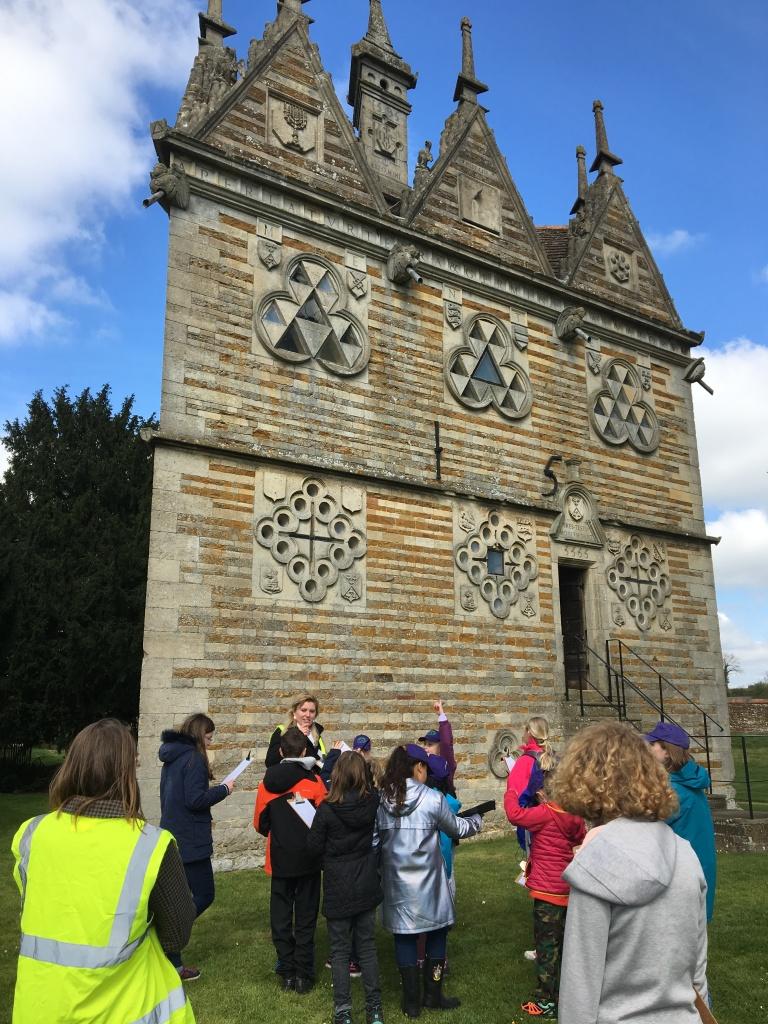 Children exploring the mysterious Rushton Triangular Lodge in Northamptonshire.