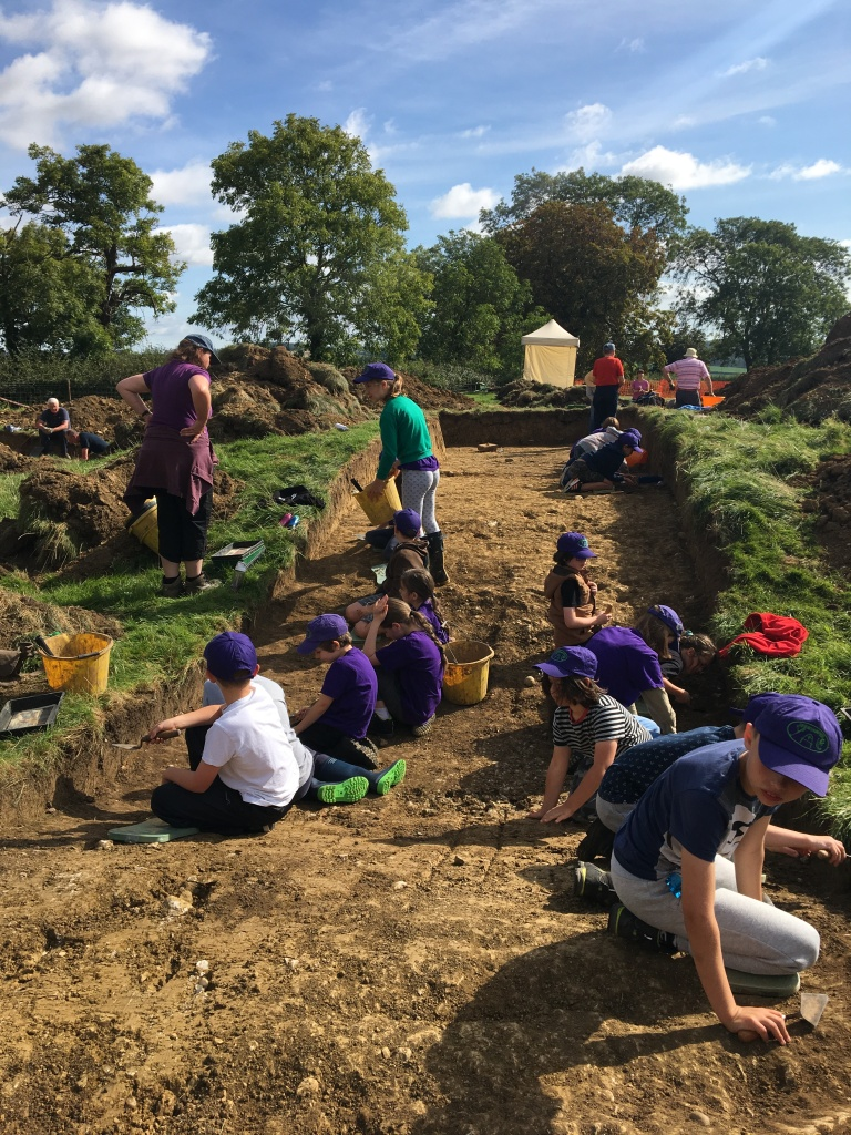 Children excavating in an archaeological trench on Hare Pie Bank at Hallaton.